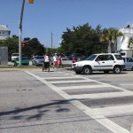 Pedestrians cross Causeway Drive using HAWK light.