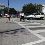 Beach goers using the HAWK light to cross Causeway Drive. Photo by Pat Bradford
