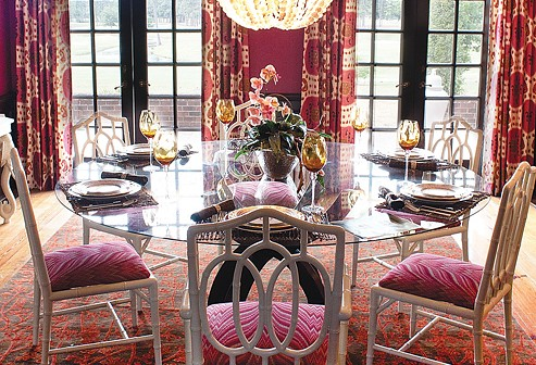 Staff photo by Emmy Errante. Meg Caswell from HGTV combined warm colors with vibrant patterns in the dining room at the Designer Showhouse hosted by the Arts Council of Wilmington and New Hanover County.