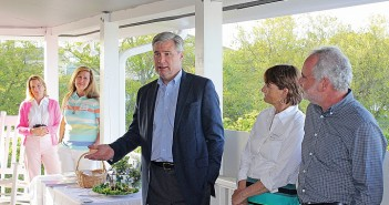Staff photo by Cole Dittmer. Rhode Island Senator Sheldon Whitehouse speaks with a group gathered at the North Carolina Coastal Federation's Southeast Office and Education Center on Monday, April 21, about global climate change while on a tour of the east coast.