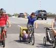 Staff photo by Cole Dittmer. Cyclists of all ages travel across the Heide Trask Drawbridge near the end of the River to Sea Bike Ride on Saturday, May 3.