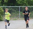 Staff photo by Cole Dittmer. Ethan Jones, left, and David Mullaney complete half a 5k around the Wrightsville Beach School track on Monday, May 12, while training with their STRIDE team for the OrthoWilmington 5k.