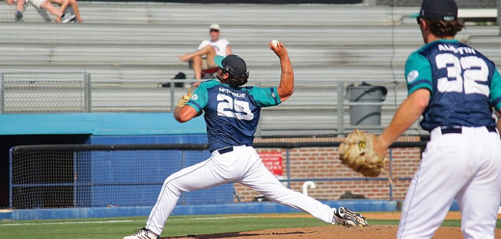 Staff photo by Cole Dittmer. University of North Carolina Wilmington baseball pitcher Nick Monroe throws a strike during the team's game against College of Charleston on Thursday, May 22, which resulted in a 7-4 loss. Charleston would advance to win the 2014 Colonial Athletic Association baseball championship on Saturday, May 24.