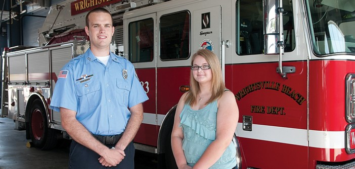 Staff photo by Allison Potter. Wrightsville Beach firefighter/intern Garrett McQueen and Sarah Pugh, daughter of fire captain Robert Pugh, have been awarded scholarships by the Wrightsville Beach Fire Department Local Relief Fund Board of Trustees to continue their educations at the University of North Carolina Wilmington and Cape Fear Community College.