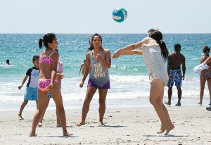 Staff photo by Emmy Errante. Beachgoers play volleyball Monday, May 26.