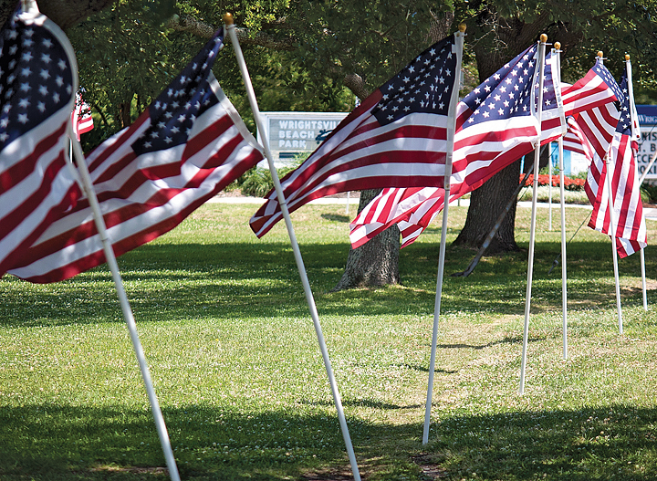 Staff photo by Emmy Errante. American flags surround Wrightsville Beach Park in honor of Memorial Day 2014.