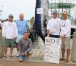 Supplied photo courtesy of Harry Archer III.  Mate Harry Archer III, from left, Capt. Burrows Smith, boat owner Ray Hales, mate Rick Beitel and angler Randy Kelley boated a 606.9 pound blue marlin aboard the Eye Catcher at the Big Rock Blue Marlin Tournament in Morehead City on Monday, June 9. Wrightsville Beach is home for the boat and crew.