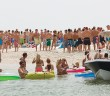 Lumina News file photo. People gather on the western side of Masonboro Island on July 4, 2011. Public safety officials from Wrightsville Beach, New Hanover County and United States Coast Guard will work together to patrol Wrightsville Beach and Masonboro Island during the Fourth of July holiday.