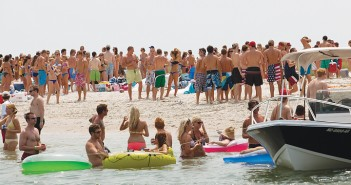 Lumina News file photo. People gather on the western side of Masonboro Island on July 4, 2011.