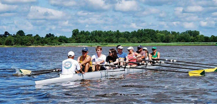 Supplied photo courtesy of John Rea. Cape Fear River Rowing Club members and visitors row an eight-person shell during the club's celebration of National Learn to Row Day on June 1, 2013.