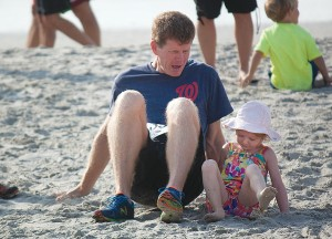 Staff photo by Emmy Errante. Lunsford King helps his daughter, Kate, finish the Kid's Crab Crawl during the 2nd Annual Pier to Pier Run/Walk, Crab Crawl and SUP Race on Saturday, June 7 at Wrightsville Beach.