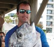 Staff photo by Emmy Errante. Chris Brooks caught a 34.4-pound African Pompano to win that category of the Wrightsville Beach Spearfishing Tournament on Sunday, June 22.