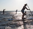 Lumina News file photo. Competitors paddle in windy, choppy conditions in Banks Channel during the Sunset SUP Series on June 13, 2013.