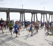 Wrightsville Beach hosts the annual Pier to Pier beach run between Johnnie Mercer's and Crystal Pier, Saturday, June 7. Staff photo Emmy Errante