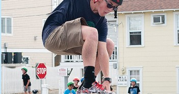 Staff photo by Allison Potter.  Dylan Foster practices maneuvers on a ramp during Skate Day in the Robert's Grocery parking lot on Friday, May 30.