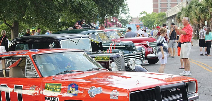 Staff photo by Cole Dittmer. Wilmington Realtor Michelle Clark's 1969 Dodge Charger General Lee was one of the many antique autos to stop by downtown Wilmington along the 2014 Great Race, which followed a course from Maine to Florida.