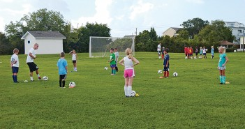Lumina News file photo. Hammerheads player Luke Holmes, demonstrates a passing drill to campers on August 6, 2012 in Wrightsville Beach Park.