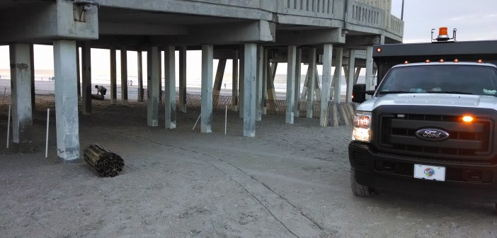 Town of Wrightsville Beach Public Works crews work on establishing a command post for public safety officials on the beach underneath Johnnie Mercer's Pier.