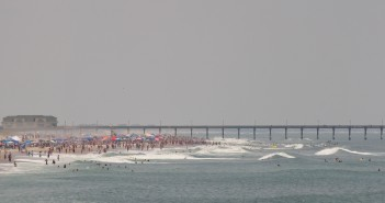 Beachgoers enjoy the waters around Johnnie Mercer's Pier on the Fourth of July 2014.