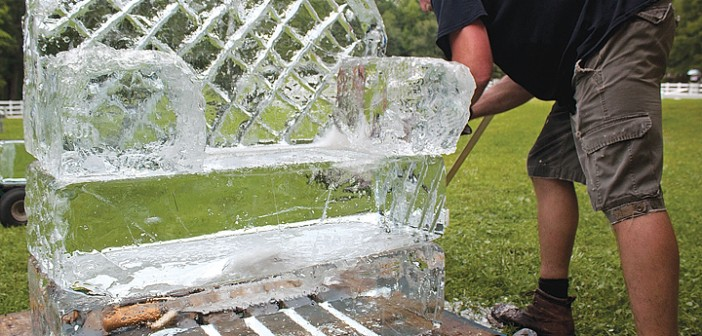"Staff photo by Emmy Errante. Michael ""Ski"" Kowalski from Ice Sensations carves a pattern into an ice sculpture for a party at Landis Farm on Saturday, June 28."