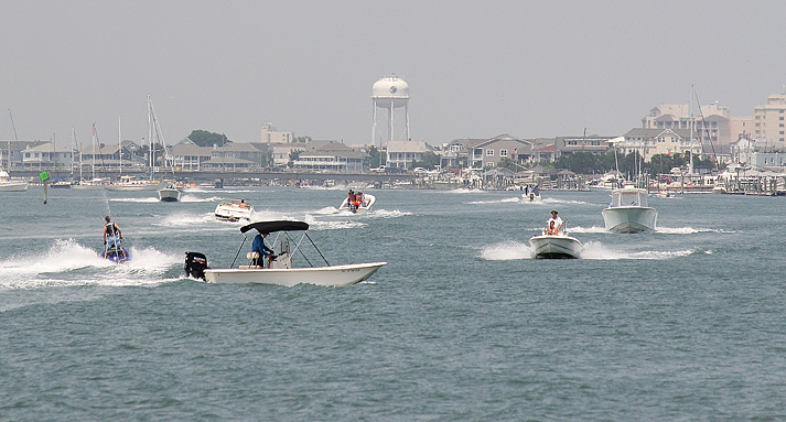Staff photo by Cole Dittmer. Watercraft of all kinds packs Banks Channel mid afternoon on the Fourth of July.