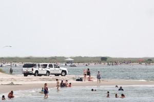 Staff photo by Cole Dittmer. Wrightsville Beach Police Department patrols watch the south end of Wrightsville Beach while also watching for swimmers attempting to cross Masonboro Inlet on the Fourth of July.
