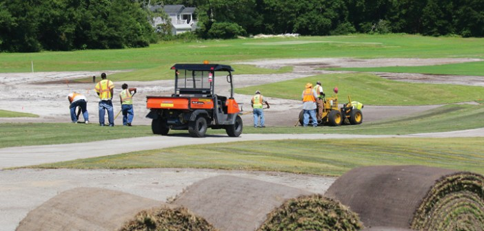 Staff photo by Cole Dittimer. Crews work on the approach area of the Wilmington Municipal Golf Course's par five No. 9, on Friday, July 18, as part of the $1.2 million course renovation.