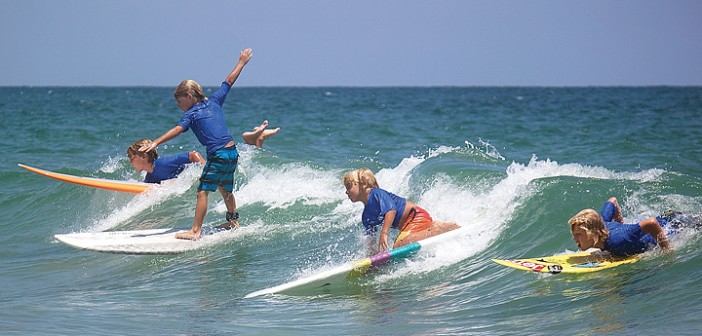 Staff photo by Emmy Errante. Children surf in the guppy division during the ninth annual O'Neill Sweetwater Pro-Am Surf Fest at Wrightsville Beach Saturday, July 12.