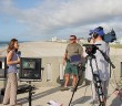 Staff photo by Cole Dittmer. Town of Wrightsville Beach park ranger Shannon Slocum is interviewed by The Weather Channel correspondent Raegan Medgie on Johnnie Mercer's Pier about preparations for tropical storm Arthur on Wednesday, July 2.