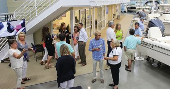 Staff photo by Cole Dittmer. The Wrightsville Beach Chamber of Commerce and Atlantic Marine hosted a chamber social at Atlantic Marine's new showroom Monday, July 28.