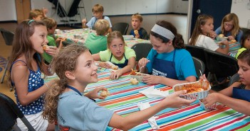 Staff photo by Allison Potter. Haley Thomas, from left, Claire Parker, Isabella Bufalini and Haley Wood eat manicotti and monkey bread that they helped prepare during the Wrightsville Beach Parks and Recreation's Kids' Cooking Camp Friday, June 27 in the Fran Russ Recreation Center.