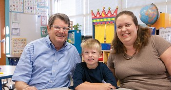 Staff photo by Allison Potter. Deaglan Alexander, center, attends his first day at Wrightsville Beach School Tuesday, Aug. 26, flanked by his mother, Katie Alexander, and grandfather, Brett Blizzard, both former WBS students.