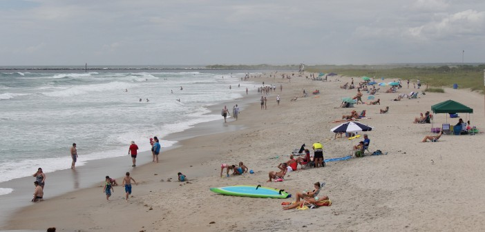 Beachgoers take advantage of the sun rays after days of rain at Wrightsville Beach on Tuesday, Aug. 5.