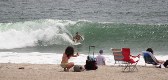 Selfies on the beach, gnarly waves in the ocean around Charlotte Street on Tuesday, Aug. 5.