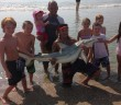 Photo provided by Maureen White. Kenny Hand poses with the blacktip shark he pulled from the waters near Wrightsville Beach on Aug. 7.