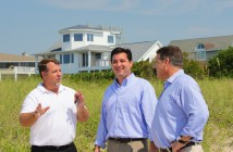 Staff photo by Cole Dittmer. Wrightsville Beach Town Manager Tim Owens shows David Rouzer and U.S. Rep. Bill Shuster the jetties at Masonboro Inlet during an Aug. 29 visit to Wrightsville Beach.