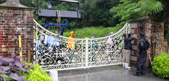 Crews work to reinstall the Airlie gate at the front entrance to Airlie Gardens on Monday, Aug. 4.