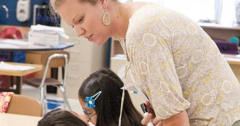 Lumina News file photo. Teacher Jessica Alphin helps a student at the Read to Achieve camp at Bradley Creek Elementary School July 16.