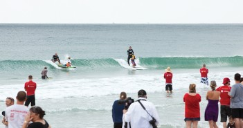 Lumina News file photo. Parents and spectators gathered along the shoreline to watch children with autism surf during the annual Surfers Healing event Aug. 20, 2012.