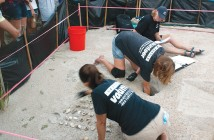 Lumina News file photo. Volunteers look for turtle hatchlings at Wrightsville Beach Acess 34 during a turtle nest excavation Tuesday, July 29.