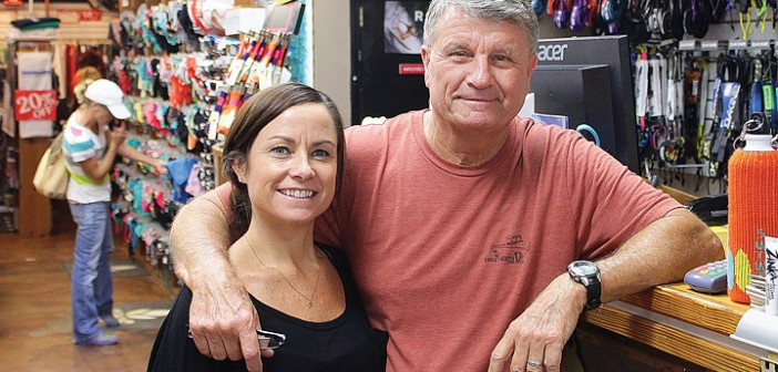 Staff photo by Cole Dittmer.  Sweetwater Surf Shop owner Chuck Bourgeois said one of the keys to sustained success at the surf shop has been the help of the next generation, his daughters Danielle, pictured here, and Shana.