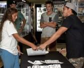 Makua Rothman signs autographs at Surf City Surf Shop