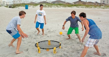 Staff photo by Emmy Errante. Matt Stevens, Evan Fersinger, Cade Edwards and Carson Edwards play spikeball Friday, Aug. 22 at Wrightsville Beach.