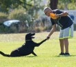Lumina News file photo. Dave Skare and Lewis shake before starting the first heat of Bark in the Park Oct. 5, 2013.