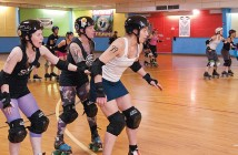 Lumina News file photo. Michelle Ingraham a.k.a. Fiona Fatale, Catherine Henning a.k.a. Busty Rhymes and Cal Cutler a.k.a. Mad Cal perform drills during Cape Fear Roller Girls practice at Jellybeans Family Skate Center Feb. 13.