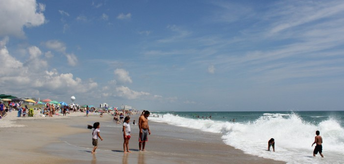 Families enjoy the shore break just north of Crystal Pier on Labor Day Monday, Sept. 1.