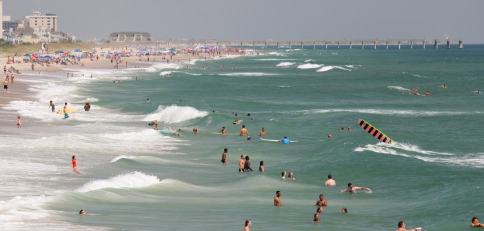 Swimmers, surfers and beachgoers find reprieve from the heat on Labor Day Monday in Wrightsville Beach.