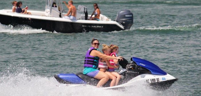 A woman and two small girls ride a jet ski in Banks Channel on Labor Day Monday, Sept. 1.