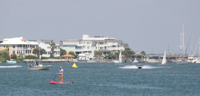 Standup paddleboarders, boaters and jet skiers fill Banks Channel on Labor Day Monday, Sept. 1.