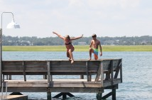 Mary Suzanne Moore and Joe Stott jump off the Banks Channel dock of the Hanover Seaside Club around high tide on Labor Day Monday, Sept. 1.